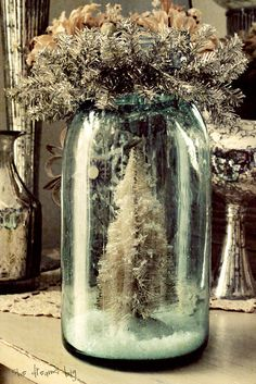 bottle brush tree in an aqua canning jar - charming!