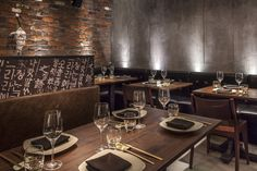 Basement restaurant. Korean Asian. Concrete and brick walls. Booth banquette seating. Designed by award winning Interior Designers Tibbatts Abel www.tibbattsabel.com