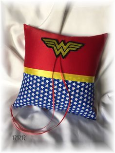 Wonder Woman Wedding Ring Bearer Pillow, Red and Blue Ring Pillow, Sci fi Wedding Ring Pillow, Red Ring Pillow, Superhero Wedding by RammaRuRu on Etsy https://www.etsy.com/listing/267521941/wonder-woman-wedding-ring-bearer-pillow