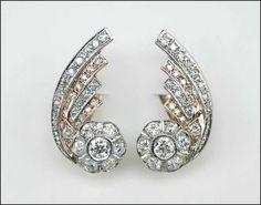 A PAIR OF DIAMOND AND 14 KARAT GOLD EARRINGS. Lot 150-7400 #jewelry