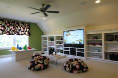 This looks a lot like our new bonus room/play room. I would love to have built ins for the toys!