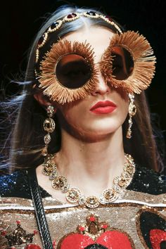 """The raffia sunglasses at Dolce & Gabbana. [link url=""""http://www.vogue.co.uk/shows/spring-summer-2018-ready-to-wear/dolce-gabbana""""]Read the [i]Vogue[/i] verdict on the show here[/link]."""
