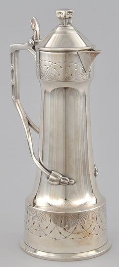 "WMF Arts and Crafts Silverplated Wine Flagon, Germany, early 20th Century. Tapered form, the handle divided into two floral stems. Etched floral design. Stamped with WURTTEMBERGISCHE METALLWARENFABRIK ""WMF Ostrich"" mark, and ""WMF G I/O OX"" on the bottom; ""I/O 8"" on lid hinge. Measures . 13""H x 6""W x 5-1/8""D  