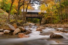 The Flume is a natural gorge in the White Mountains of New Hampshire. The gorge includes waterfalls and covered bridges like the Flume Bridge featured here.