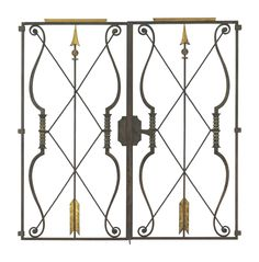 GILBERT POILLERAT (1902-1988) A Pair of Parcel-Gilt Wrought-Iron Gates, circa 1945 each 54¾ in. (137.1 cm.) high, 27¾ in. (70.5 cm.) wide, 1¼ in. (3.2 cm.) deep (2)