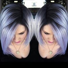 gorgeous dark roots with lavender hair