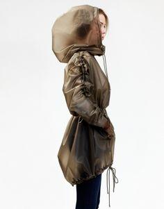 Fashion -><- Function Cute parka style rain coat where the hood fits over your bike helmet! Stylish Raincoats, Raincoats For Women, Green Raincoat, Hooded Raincoat, Designer Raincoats, Rain Gear, Trench Coats, Rain Coats, Stella Mccartney