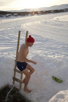 Winter swimming in Finland by Visit Finland via Flickr. (I've done it and it's...shocking! Same with lying down in the snow. After a hot sauna, though, it's hard to differentiate between hot & cold, I've found.) :)