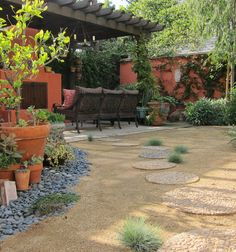 Low maintenance yard with DG and stepping stones, patio, vivid painted walls