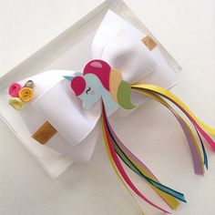 Unicorn Hair Bow. The bow measure approx. 4.5 inches across. Alligator clip ( French Barrete / elastic headband just let me know and I can change the way you like it). All ribbon ends are heat sealed to prevent fraying. ** Disclaimer ** All items sold in my shop may contain small parts do not leave small children and babies unattended while wearing as they may pose a choking hazard. Like me on Facebook and follow my work. Thank you! www.facebook.com/AurorasChicBowtique Add Auro... Kids Hair Bows, Girls Bows, Diy Ribbon, Ribbon Bows, Minnie Mouse Bow, Ribbon Headbands, Ribbon Sculpture, Alligators, Boutique Hair Bows