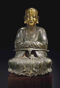 A RARE PARCEL-GILT BRONZE FIGURE OF SHOULAO -  CHINA, MING DYNASTY, 16TH-17TH CENTURY.