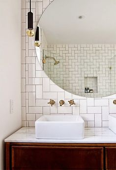 An Art Deco bathroom | love the huge round mirror