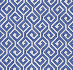 Kyra Key Fabric A woven fabric with an interlocking geometric design in blue and ivory. F+Papers