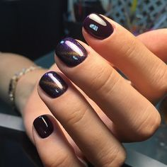 The nail design is simple with a shimmering nail polish.
