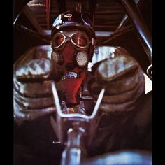 Driver...Suited up...Holding the unique butterfly steering wheel. Great Picture.