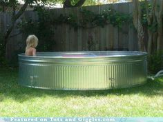 Every kid should be so lucky as to have some clean water to splash in on a hot day! Rather than buying a plastic or inflatable kiddie pool, consider investing in a stock tank for use as a back yard pool. Check your local Craigslist for a used tank, or find one at a local feed store.
