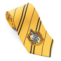 It's hard to be a Potter geek when your office dress code doesn't exactly encourage the wearing of robes.  How does one communicate to other witches and wizards without offending the Muggles? It's as simple as putting on a very special tie.