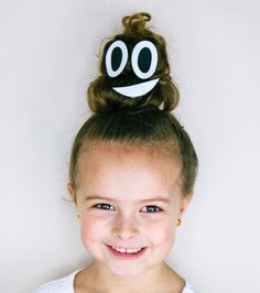 Yep! That would be a on top of her head! It was a HUGE hit on crazy hair day at school and we shared how to recreate it today! Pin it for later, to save it for any upcoming Wacky Hair Days ahead! #crazyhairday #wackyhairday