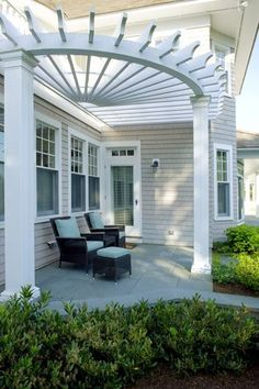 A semi-circular pergola off the back of this house by SuCasa Designs creates a relaxing place to enjoy the outdoors.
