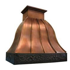 copper range hood with bell curve, standing seams and repousse border