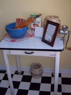 Enamel top table with vintage kitchen items