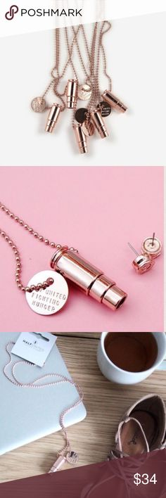 """SALERose Gold Fighting Hunger Bullet Necklace When sibling co founders, Carmin and Christian Black founded HU in 2009 they were looking for a product to represent their united fight against hunger.  Originally designed using recycled bullet casings donated by a friend. Every HU product sold provides 7 meals for a child in need! Rose gold plated bullet and charm pendant. Handcrafted 30"""" rose gold ball chain. New with tag! This is awesome!! 1,000,000 meal goal for 2016. Listing is for 1…"""