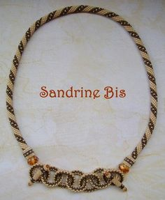 Sandrine's bead crochet.  Intertwined rings (as the focal) are secured by toggles.