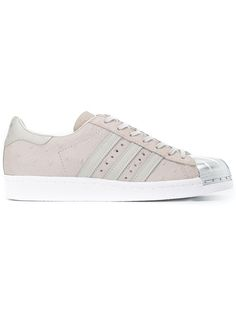 Nude and silver cotton and leather 'Superstar 80's' metal toe sneakers from Adidas Originals featuring a lace-up front fastening, a brand embossed tongue, a branded insole, a padded ankle, appliqué stripes at the sides, an ostrich leather effect, branded heel counter, a white rubber sole and a signature shell toe. Size: 6.5. Color: Nude/neutrals. Gender: Female. Material: Cotton/Leather/rubber.