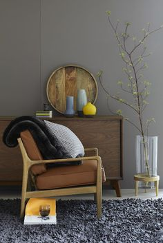 I love how the charcoal gray enlivens and modernizes the vintage pieces