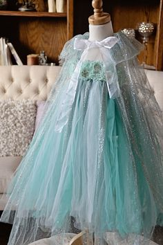 Our stunningElsa inspired tutu dress, complete with a sparkling floor length flowing cape and coordinating hair flower headband is a must have!! The ultimate c