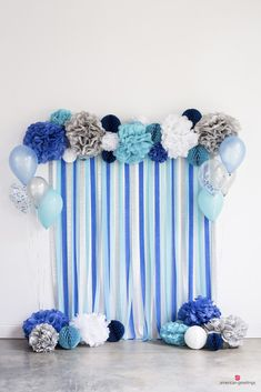 Blue, white, and silver photo backdrop made of tissue crepe paper and pom-poms--on mint greenWe've gathered our favorite blue birthday party ideas with our favorite blue party supplies. Quick and easy to celebrate a loved ones Ideas For W Baby Shower Cakes, Baby Shower Parties, Baby Shower Themes, Shower Party, Baby Shower Blue, Boy Baby Showers, Baby Blue, Baby Shower Backdrop, Blue Birthday Parties