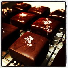 Perfecting our Valentine's Day Treats. Hand-dipped caramels with dark chocolate and sea salt