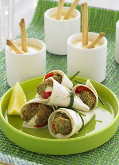Falafel wraps with hummus and pickled chilli - quick, easy and stylish canapés that are great for any party. You can find pickled chillies from Middle Eastern delis and larger supermarkets