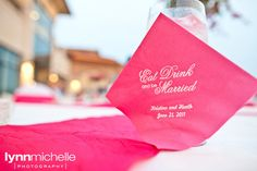 "hot pink themed wedding, ""Eat, Drink, and be Married"" text on hot pink personalized napkins."