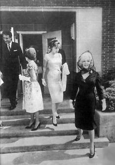 Marilyn leaving the christening of John Gable (Clark Gable's son), 11 June 1961.