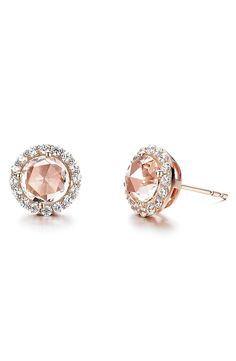 Faceted and versatile, these shimmering rose gold stud earrings are centered with softly pink colored jewels and framed with twinkling simulated diamonds.