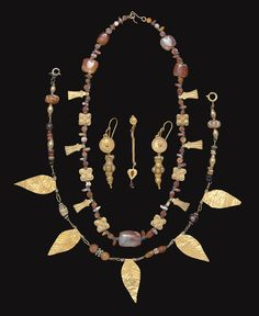 A GROUP OF ROMAN GOLD JEWELRY ELEMENTS -  CIRCA 1ST-3RD CENTURY A.D.