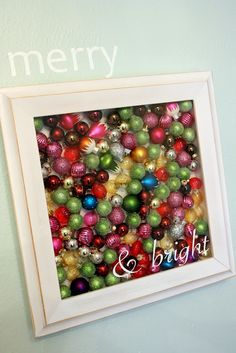 Fill a shadow box with ornaments. Vinyl lettering or stickers in bottom corner. This would be cute filled with jingle bells too! I could use this idea for older ornaments that don't always get placed on the tree... but for a large amount of balls I prefer a wreath...