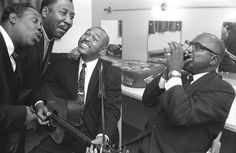 Backstage somewhere in the Midlands during a blues tour around 1964. Muddy Waters and Otis Spann jam with Sonny Terry and Brownie McGee in between sets.