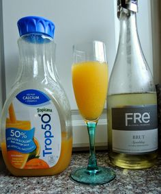 Eat Drink And Be Me: Skinny Pregnant Girl Mimosa - Finally, a mocktail I can drink with a baby on the way that actually tastes like the real thing!  It's perfect for Mother's Day brunch, and it's super low-cal (only 30 calories) when you use Trop50 instead of full-cal orange juice.  Thanks, Fre Brut for a decent non-alcoholic sparkling wine!
