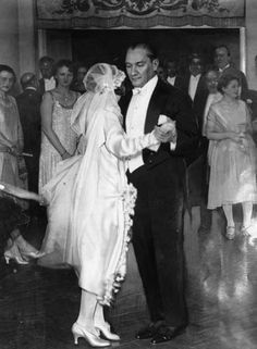 Atatürk dancing with his adopted daughter at her wedding in 1925