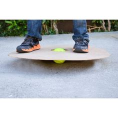 A wobble board helps you to develop balance and coordination as well as strength in the core knees and ankles A board is placed on top of an unstable round point of balan. Gross Motor Activities, Activities For Kids, Diy For Kids, Crafts For Kids, Homemade Board Games, Homemade Toys, Wood Toys, Diy Toys, Kids Playing