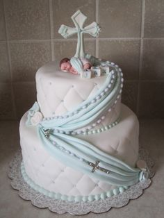 "9"" and 6"" round cakes, covered in fondant with fondant details, fondant cross, gum paste baby, real rosary beads"