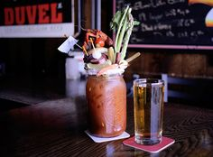 The greatest Bloody Mary ever. Includes the standard tomato juice and vodka — followed by a crawfish, a bacon cheeseburger, a shrimp, cheese, beef jerky, asparagus, Brussels sprouts, green beans, okra, onions, tomatoes, olives, a pickle. And, for good measure, a half pint of beer.