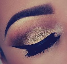 Shimmery gold against dark black liner.