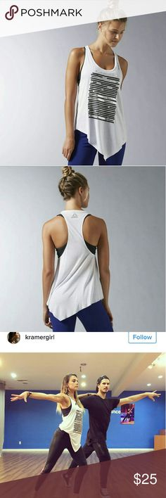 "Reebok Dance Asymmetrical Tank Some days the workout happens right after the work day. This tank transitions perfectly from out-and-about to working up a sweat. Movement comes easy with the racerback design, and a modern take on the hemline sways and moves when you do. 50% Modal / 50% Draylon fabric for softness and drape. As seen on Jana Kramer on DWTS! Brand new only worn once but I did cut the tags out as they bothered me.  The graphic says ""Something about them made him look twice- leave…"