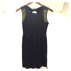 Key Hole Back Cut Out Studded Shoulders Dress Adorable little black dress with gold studded shoulders. And a gorgeous key hole cut out in the back. Great condition. Worn twice! Boutique Dresses