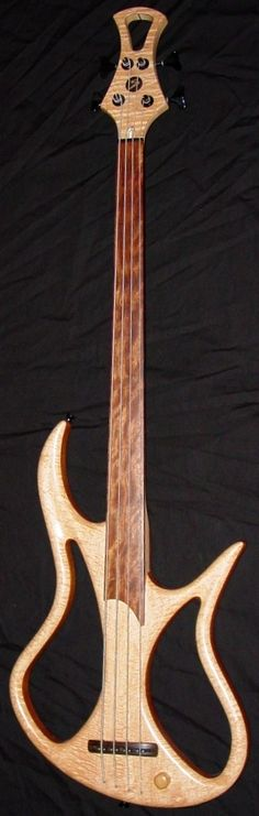 Chris Stambaugh custom Bass - FRETLESS with lovely quilt pattern neck, unusual lighter wood headstock. RESEARCH #DianaDeeOsborne BASSes OF LIFE - https://www.pinterest.com/DianaDeeOsborne/basses-of-life/ - Luthier from Alton Bay, New Hampshire creates gorgeous custom- made guitars that sound as good as they look. Has operated #Stambaugh Musical Designs right from his own home since 1994. Photo pinned via lardyfatboy #Bass #Pinterest board