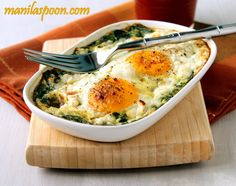 Baked Spinach and Eggs 6 cups firmly packedbaby spinach or 1(10 oz or up to 1 lb)bag fresh baby spinach*  4 eggs(can increase to6 if you are using more spinach)  Salt and freshly Ground Pepper, to taste  1 Tbspcrumbled FetaCheesefor 1-2 eggs (about 2-3Tbps in total)  Baking spray or a little oil for greasing