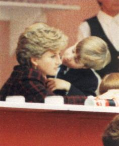December 17, 1990: Princess Diana With William And Prince Harry At The International Horse Show, Olympia, London, Britain..A tender moment between mother Princess Diana and son Prince William..